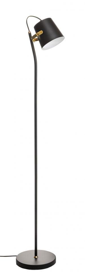 Metallinen lattiavalaisin. Jalkalamppu on väriltään musta, koristeosien väri on messinki. Varjostimen sisäpuoli on valkoinen.