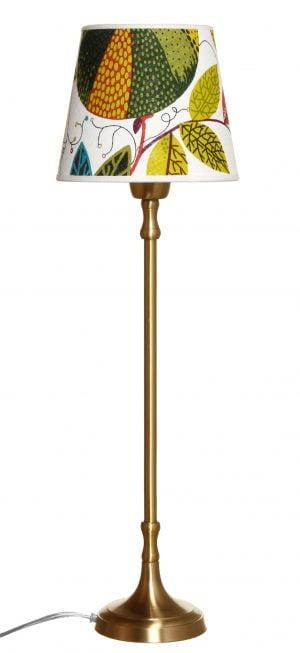 Metallinen lampunjalka jonka väri on messinki. Varjostin on värikäs.