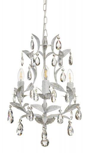 Kristallikruunu jossa on kolme kantaa. Valaisimen runko on väriltään antik valkoinen seassa ripaus kultaa.
