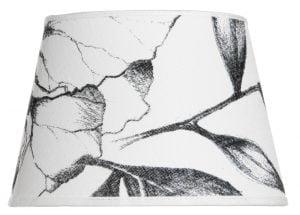Lampunvarjostin jossa on musta kukkakuvio. Varjostin on materiaaliltaan laminoitua kangasta.