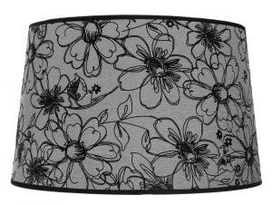 Kattolampun varjostin jonka materiaali on laminoitu kangas. Kippivarjostin on väriltään harmaa. ja siinä on musta kukkakuvio.