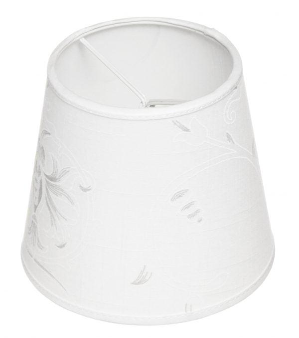 Valkoisella taustalla valokuva lampunvarjostin, joka levenee suorassa linjassa ylhäältä alaspäin. Varjostimen ylä- ja alareunat ovat kaarella. Varjostimen pohjaväri on valkoinen, ja siinä abstraktia kuviointia vaaleanharmaalla sekä valkoisella kohokuviolla. Varjostimessa on valkoiset kanttausnauhat ylä- sekä alareunassa. Varjostin on kuvattu yläviistosta, jolloin sen valkoinen sisäpinta sekä osa valkoisesta kiinnitystelineestä ovat näkyvissä.