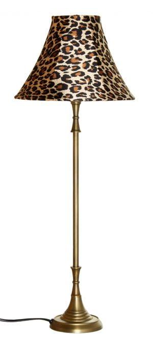 Metallinen lampunjalka jonka väri on antiikki messinki Varjostimessa on leopardi kuvio.