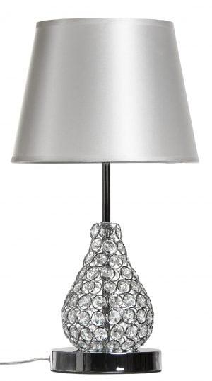 Pöytävalaisin jossa kristalli koristelu jalassa. Pöytälampun varjostimen väri on hopea ja materiaali on laminoitu kangas.
