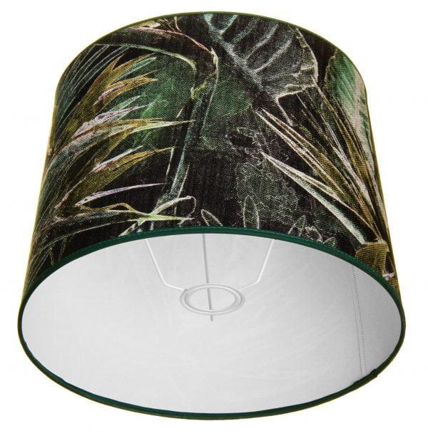 Lampunvarjostin jossa on vihreällä pohjalla lehti kuvio. Varjostin on materiaaliltaan laminoitua kangasta. Sisäpuoli on valkoinen.