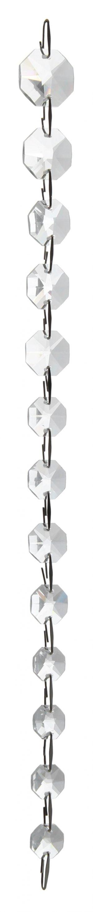 Kirkas kristalliketju, jossa on 13 kahdeksan kulmaista kristallia. Kristallit pienenevät ylhäältä alaspäin. Kristallien välissä on teräksen väriset lenkit.