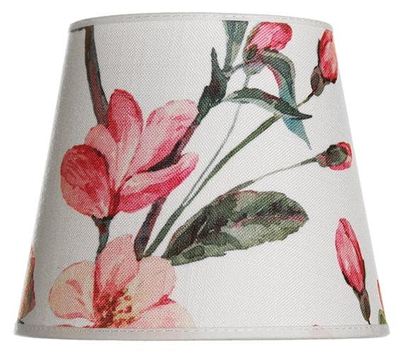 Lampunvarjostin jossa on roosa kukka kuvio. Varjostin on materiaaliltaan laminoitua kangasta.