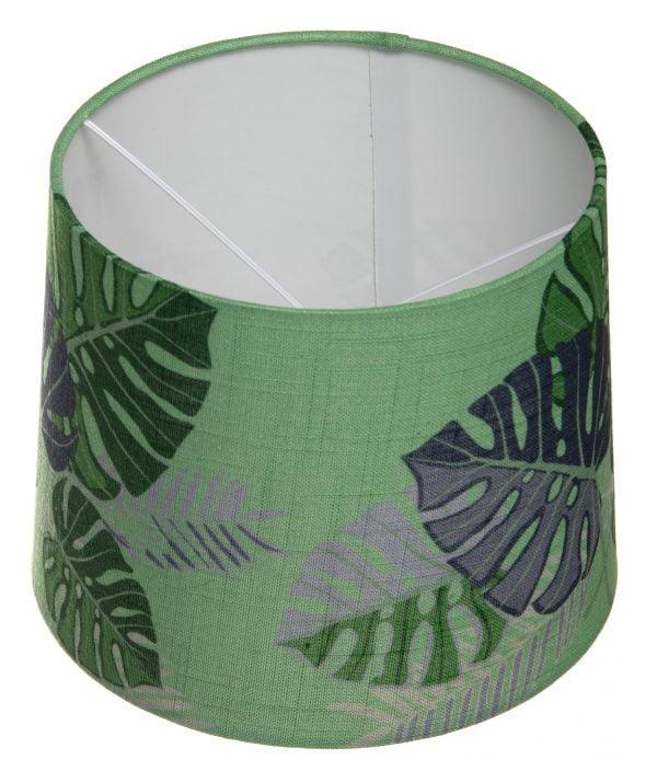 Vihreä lampunvarjostin, jossa on graafisia lehtikuvioita. Lehdet ovat vihreitä ja harmaita. Varjostin levenee hieman ylhäältä alaspäin.