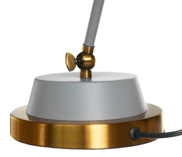 Metallinen pöytävalaisin. Pöytälamppu on väriltään harmaa ja sen tehostevärinä on antiikki kulta.